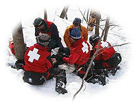 Helping out an injured skier.