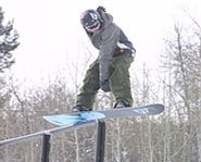 Photo of slopestyle snowboarding.