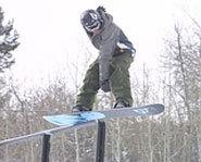 Photo of slopestyle snowboarding.