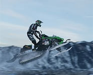 Photo of Tucker Hibbet racing snowmobiles.