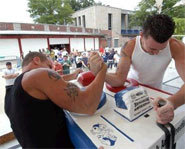Picture of arm wrestling match.