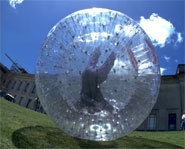 Picture of someone zorbing.