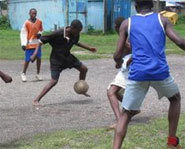 Kids in Africa play with a homemade soccer ball.