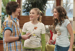 Miley Cyrus and Emily Osment star in the new Hannah Montana DVD.