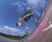 A skateboarder doing a trick.