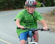 A kid competing in the cycling portion of the Ironkids Triathlon Series.