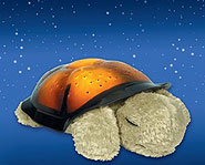 Twilight Turtle lights up and transforms your room into a starry night sky!