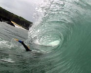 A surfer attempting a duck dive.