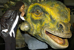 Whoopi Goldberg makes a new friend at Walking With the Dinosaurs.