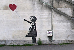British graffiti artist Banksy has sold some of his works for more than $500,000.