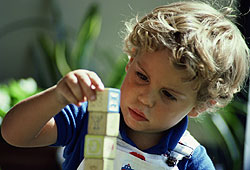 A symptom of autism is obsessively stacking or lining up objects.