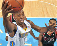 Chauncey Billups Drives the Denver Nuggets