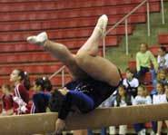 The Olympic balance beam is 16 feet, 3 inches long and 4 inches wide.