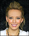 Hilary Duff slicks back her hair.